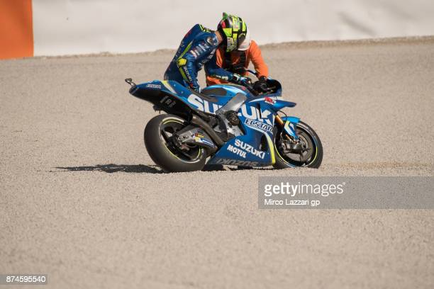 Andrea Iannone of Italy and Team Suzuki ECSTAR checks the bike after crashed out during the MotoGP Tests In Valencia day 2 at Comunitat Valenciana...