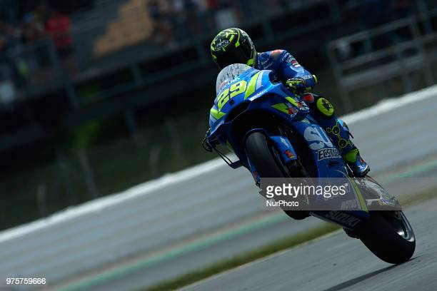 Andrea Iannone of Italy and Team Suzuki Ecstar making a wheelie during the free practice of the Gran Premi Monster Energy de Catalunya Circuit of...