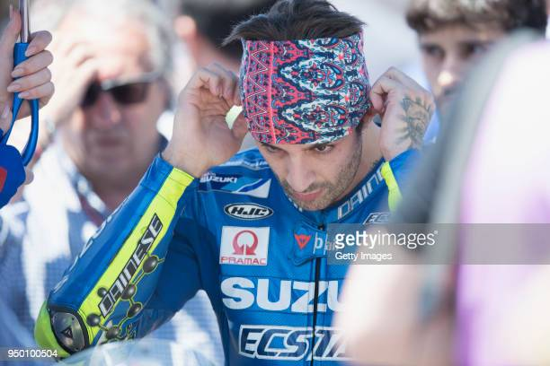 Andrea Iannone of Italy and Team Suzuki ECSTAR prepares to start on the grid during the MotoGP race during the MotoGp Red Bull US Grand Prix of The...