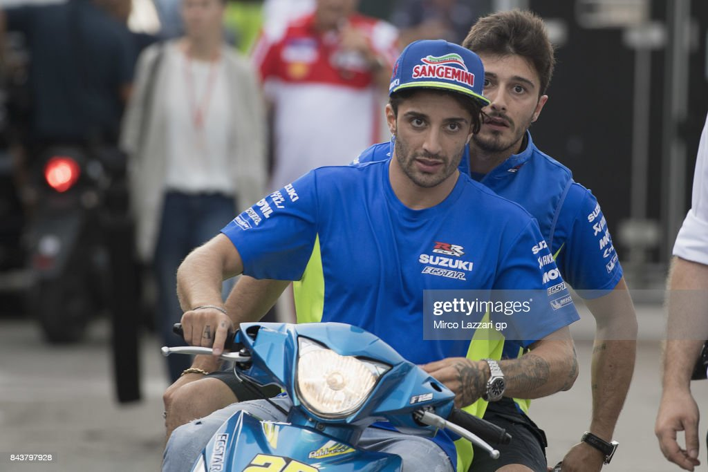 Andrea Iannone of Italy and Team Suzuki ECSTAR rides the scooter with his brother Angelo in paddock during the MotoGP of San Marino - Previews at Misano World Circuit on September 7, 2017 in Misano Adriatico, Italy.