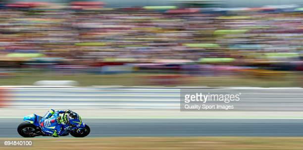 Andrea Iannone of Italy and Team Suzuki ECSTAR rounds the bend during the MotoGp race for the MotoGP of Catalunya at Circuit de Catalunya on June 11...