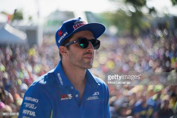 Andrea Iannone of Italy and Team Suzuki ECSTAR smiles with fans during the autographs session after the qualifying practice during the MotoGp of...