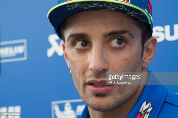 Andrea Iannone of Italy and Team Suzuki ECSTAR speaks with journalists in hospitality during the qualifying practice during the MotoGP of Aragon...