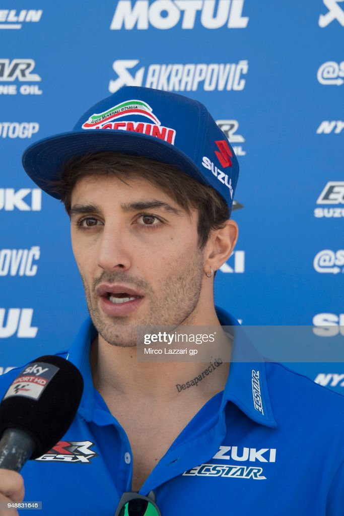 Andrea Iannone of Italy and Team Suzuki ECSTAR speaks with journalists in paddock during the MotoGp Red Bull U.S. Grand Prix of The Americas - Previews at Circuit of The Americas on April 19, 2018 in Austin, Texas.