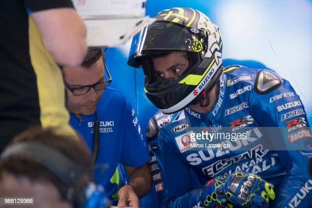 Andrea Iannone of Italy and Team Suzuki ECSTAR speaks with mechanic in box during the Qualifying practice during the MotoGP Netherlands Qualifying on...