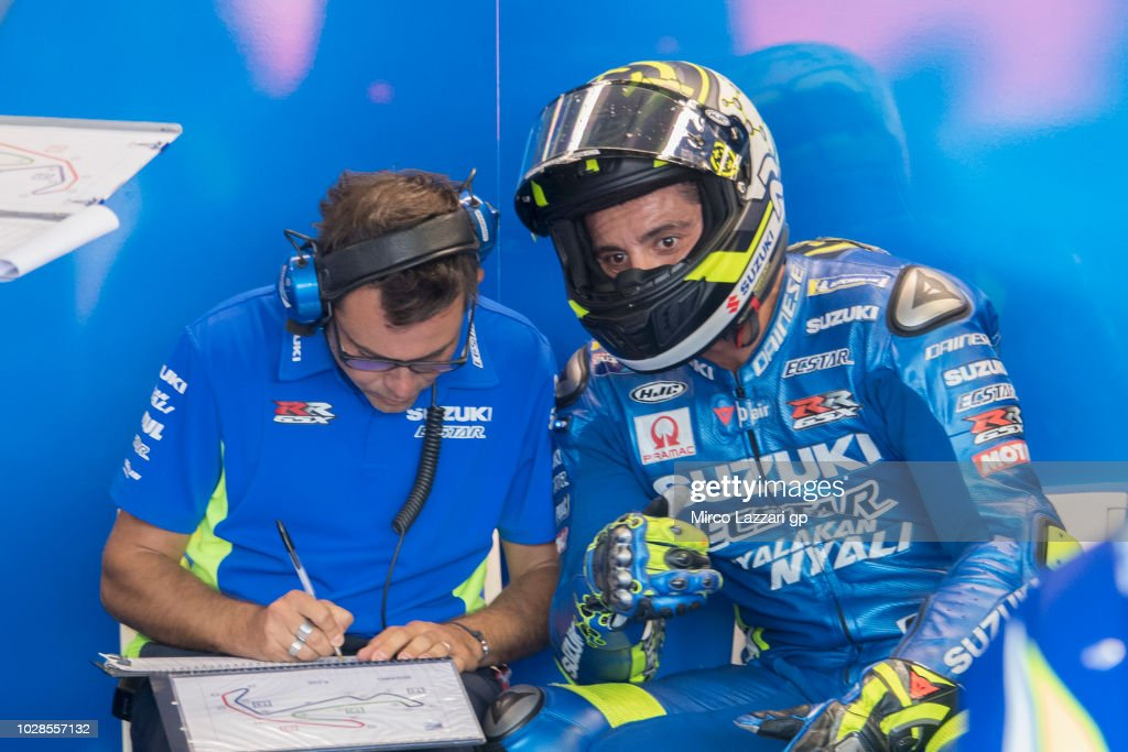 Andrea Iannone of Italy and Team Suzuki ECSTAR speaks with mechanics in box during the MotoGP of San Marino - Free Practice at Misano World Circuit on September 7, 2018 in Misano Adriatico, Italy.