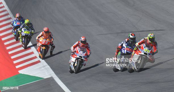 Andrea Iannone of Italy leads a pack during the MOTOGP race at the Grand Prix of Austria in Spielberg on August 14 2016 / AFP / Michal Cizek