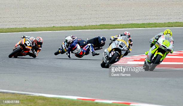 Andrea Iannone of Italy Speed Master Team leads Thomas Luthi of Switzerland InterwettenPaddock Team and Marc Marquez of Spain and Team CatalunyaCaixa...