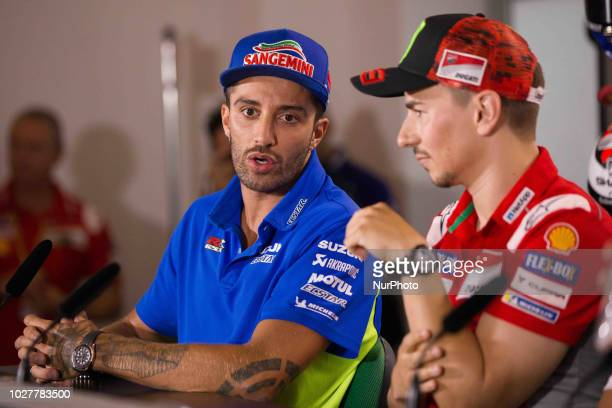 Andrea Iannone of Team Suzuki Ecstar1 talk with Jorge Lorenzo of Ducati Team during the presentation press conference of the OCTO Grand Prix of San...