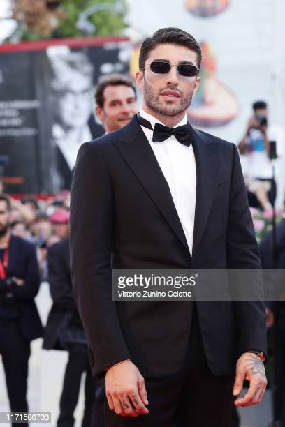 Andrea Iannone walks the red carpet ahead of the The Laundromat screening during the 76th Venice Film Festival at Sala Grande on September 01 2019 in...