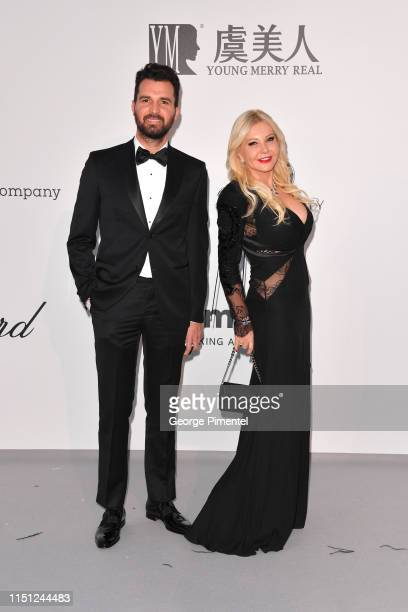 Andrea Iervolino and Monika Bacardi attend the amfAR Cannes Gala 2019 at Hotel du Cap-Eden-Roc on May 23, 2019 in Cap d'Antibes, France.