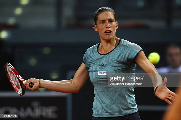 Andrea Ivanovic of Germany plays a fore hand during her doubles match between Andrea Ivanovic / Andrea Petkovic of Germany and Sarah Borwell of Great...