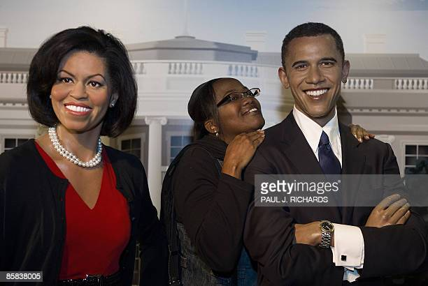 Andrea Johnson, from Tampa, Florida, gets in close for a keep sake photo at Madame Tussauds Wax Museum in Washington, DC, with the likeness of US...