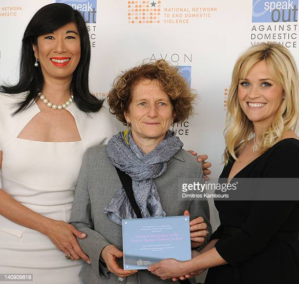 Andrea Jung and Reese Witherspoon present an Avon Global Believe Fund grant to Marcella Pirrone a board member of Italy's Donne In Rete Contro la...