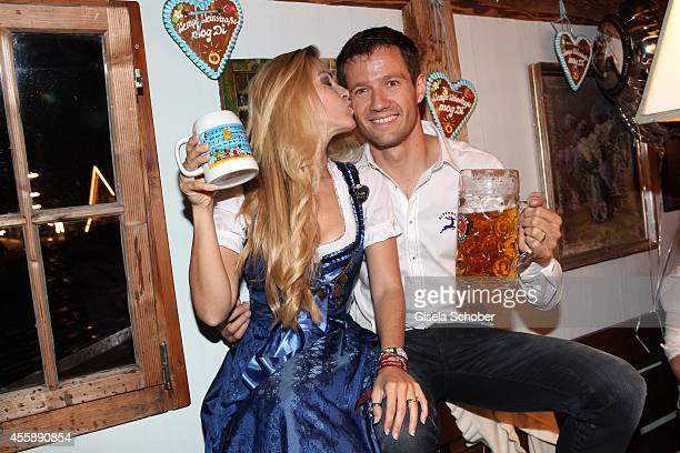 Andrea Kaiser and her husband Sebastien Ogier attend the 'Almauftrieb' at Kaefer tent during Oktoberfest at Theresienwiese on September 21 2014 in...