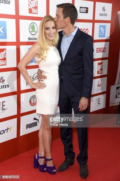 Andrea Kaiser and her husband Sebastien Ogier attend the Sport Bild Award on August 21, 2017 in Hamburg, Germany.