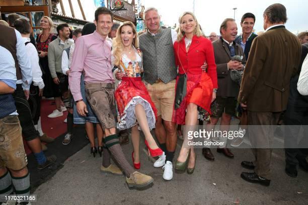 Andrea Kaiser and her husband Sebastien Ogier Stefan Bloecher and his girlfriend Anna Posch during the Laureus Wiesn as part of the Oktoberfest 2019...