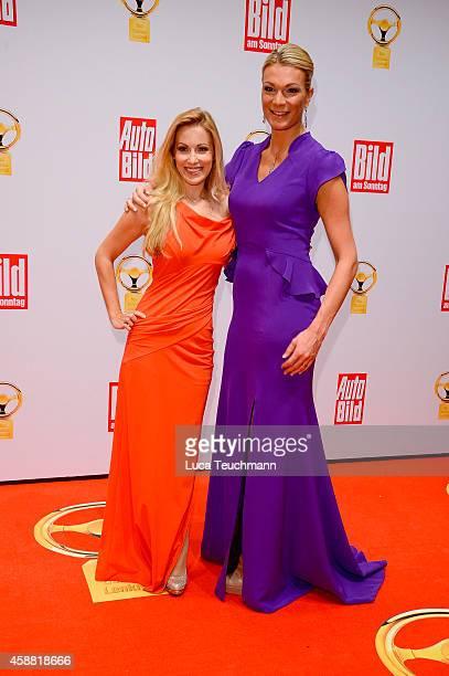 Andrea Kaiser and Maria Hoefl-Riesch attend 'Goldenes Lenkrad' Award 2014 at Axel Springer Haus on November 11, 2014 in Berlin, Germany.