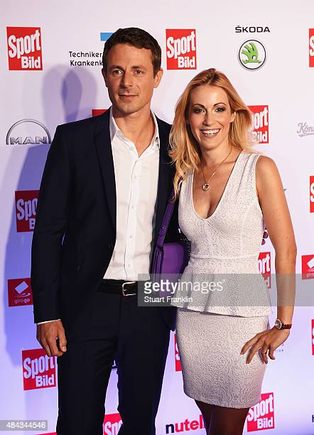 Andrea Kaiser and partner poses for a picture at the Sport Bild Awards 2015 on August 17 2015 in Hamburg Germany