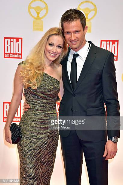 Andrea Kaiser and Sebastien Ogier attend the 'Goldenes Lenkrad' Award at Axel Springer Haus on November 8 2016 in Berlin Germany