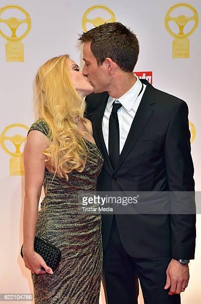 Andrea Kaiser and Sebastien Ogier attend the 'Goldenes Lenkrad' Award at Axel Springer Haus on November 8 2016 in Berlin Germany