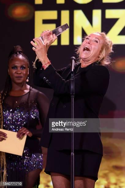 "Andrea Kiewel receives the ""Beste Moderation/Einzelleistung Unterhaltung"" award on stage during the German Television Award at Tanzbrunnen on..."