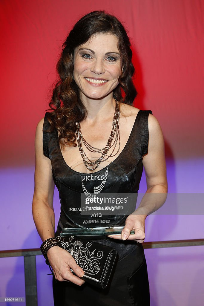 Andrea Kolb receives an award at the Victress Day Gala 2013 at the MOA Hotel on April 8, 2013 in Berlin, Germany.