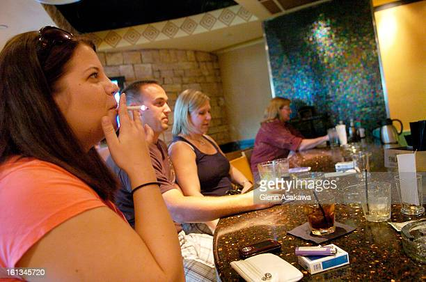 TR16DIA Andrea Kruzska <cq> of Detroit smokes a cigarette in the Mesa Verde restaurant in the A concourse at Denver International Airport on August...