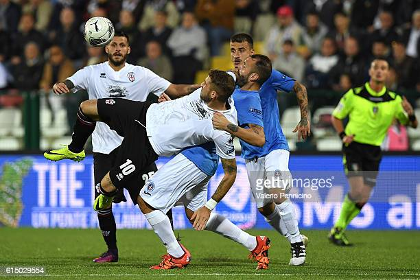 Andrea La Mantia of FC Pro Vercelli is tackled by Gennaro Scogliamiglio of Novara Calcio during the Serie B match between FC Pro Vercelli and Novara...
