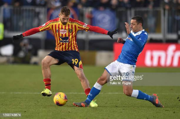 Andrea La Mantia of Lecce and Romulo Souza of Brescia compete for the ball during the Serie A match between Brescia Calcio and US Lecce at Stadio...