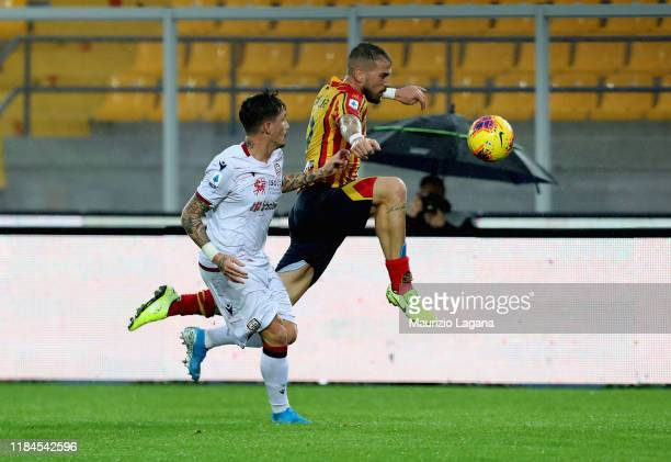 Andrea Lamantia of Lecce competes for the ball with Fabio Pisacane of Cagliari during the Serie A match between US Lecce and Cagliari Calcio at...