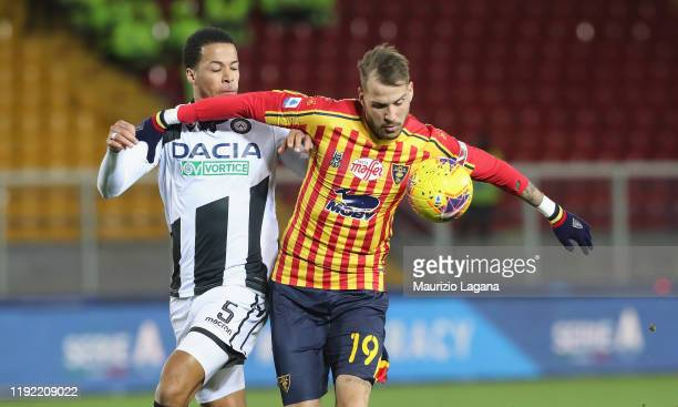 Andrea Lamantia of Lecce competes for the ball with William Ekong of Udinese during the Serie A match between US Lecce and Udinese Calcio at Stadio...