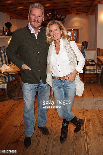 Andrea L'Arronge and her husband Charly Reichenwallner pose during the NeujahrsKarpfenessen in Hotel zur Tenne on January 06 2015 in Kitzbuehel...