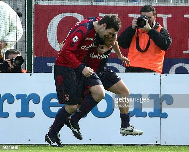 Andrea Lazzari and Andrea Cossu of Cagliari celebrate a goal during the Serie A match between Cagliari Calcio and Parma FC at Stadio Sant'Elia on...