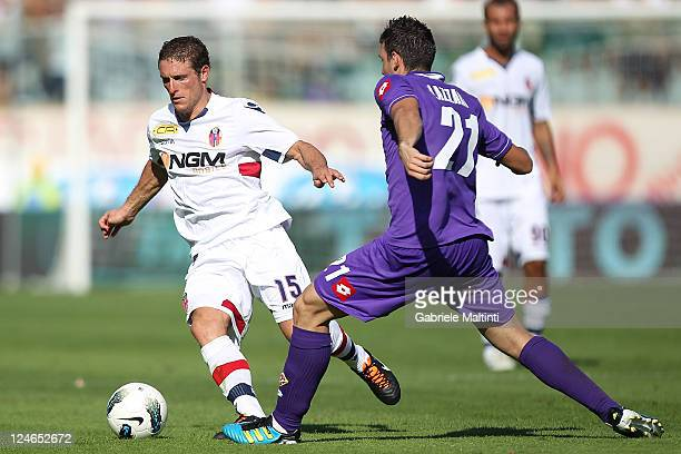 Andrea Lazzari of ACF Fiorentina fights for the ball with Diego Fernando Perezi of Bologna FC during the Serie A match between ACF Fiorentina and...