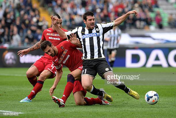 Andrea Lazzari of Udinese is challenged by Davide Astori of Cagliari during the Serie A match between Udinese Calcio and Cagliari Calcio at Stadio...