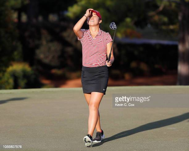 Andrea Lee of the Stanford Cardinal reacts after missing her putt on the 16th green against Gabi Ruffels of the USC Trojans during day three of the...