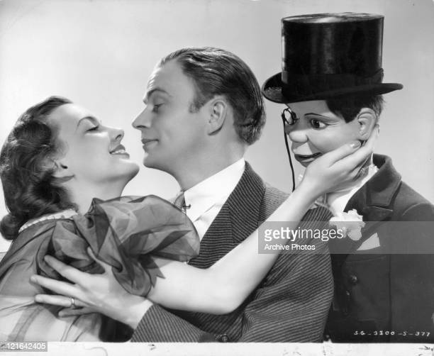 Andrea Leeds embracing Edgar Bergan with Charlie McCarthy doll in a scene from the film 'The Goldwyn Follies' 1938