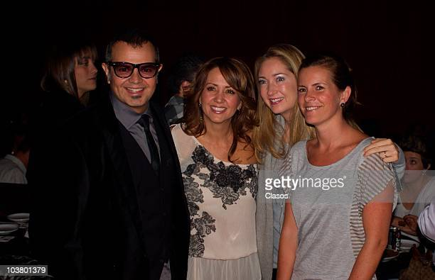 Andrea Legarreta and Alex Sintek pose for photographers during a concert of Erik Rubin on August 31 2010 in Mexico City Mexico