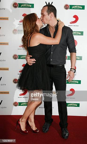 Andrea Legarreta and Erick Rubin pose for photos at the red carpet of the launch of the video Tu Voz at W Hotel on August 6 2010 in Mexico City Mexico