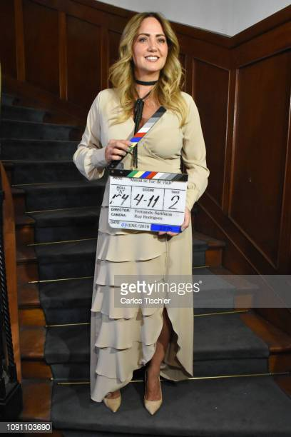 Andrea Legarreta poses for photos with a clapperboard during the filming of the movie 'Mama se fue de viaje' at Circulo Cubano de Mexico on January 7...
