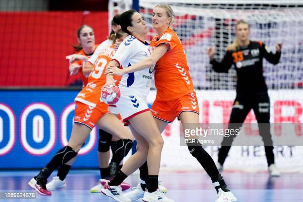 Andrea Lekic of Serbia controls the ball against Kelly Dulfer of Netherlands during the Women's EHF Euro 2020 match between Netherlands and Serbia at...