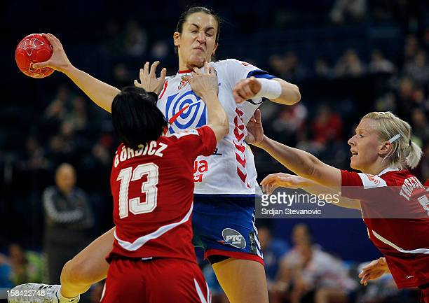 Andrea Lekic of Serbia is challenged by Anita Gorbicz of Hungary during the Women's European Handball Championship 2012 third place match between...