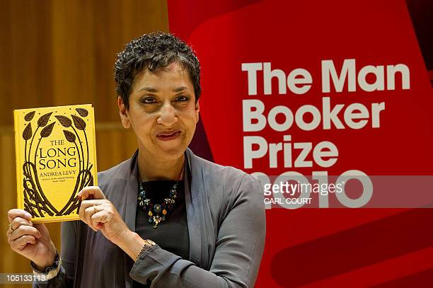 Andrea Levy shortlisted for the Man Booker literary prize poses with her book The Long Song at the Royal Festival Hall in London England on October...