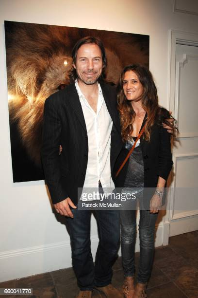 Andrea LinettWaring and Michael Waring attend ANDREW LEVITAS works on canvas and steel curated by NEIL GRAYSON at Dactyl Gallery on May 9 2009 in New...
