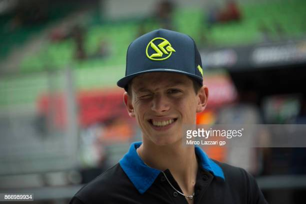 Andrea Locatelli of Italy and Italtrans Racing Team smiles in pit during the MotoGP Of Malaysia Free Practice at Sepang Circuit on October 27 2017 in...