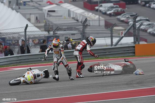 Andrea Locatelli of Italy and san Carlo Team Italia and Arthur Sissis of Australia and Mahindra Racing crashed out during the Moto3 race during the...