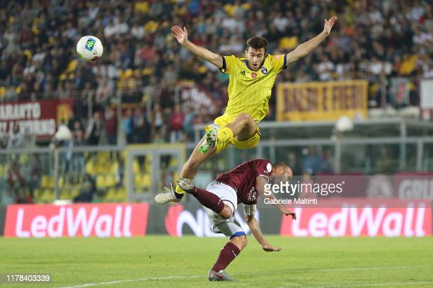 Andrea Luci of AS Livorno battles for the ball with Samuele Birindelli of Pisa SC during the Serie B match between AS Livorno and Pisa SC at Stadio...