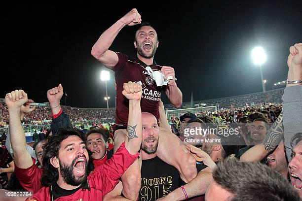 Andrea Luci of AS Livorno celebrates after winning promotion to the Serie A during the Serie B playoff final match between AS Livorno and Empoli FC...