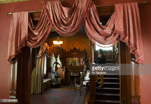 Andrea Malcomb Museum Director fo The Molly Brown House Museum stands on the wooden stairs in the home's entryway after a $13 million restoration and...